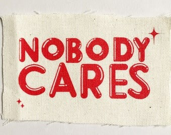 Nobody Cares red hand silkscreened patch