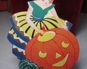 RESERVED 4 D Art Deco 1930's large unused gold gilded die cut halloween bridge tally card pretty girl putting candle into jack o lantern