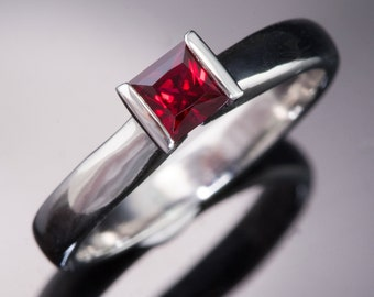 Princess Cut Chatham Created Ruby Modified Tension Solitaire Engagement Ring, in Palladium, Rose Gold, Yellow Gold, White Gold, Platinum