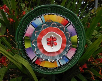 Glass Flower Garden Art  Ensemble with Plates, Glass, Ceramic, and other Treasures, Yard Art Flower