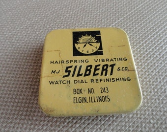 B977)  Vintage MJ Silbert & Co. Tin watch dial and hairspings  vintage tin