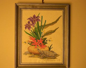 Ikebana and turtle embroidery, framed in silver