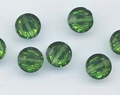 Twelve beautiful vintage Swarovski crystals - art 5100 - 8 mm - green turmaline aurora borealis