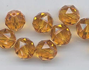 Twelve Swarovski crystals - art 5025 - 8 mm - topaz