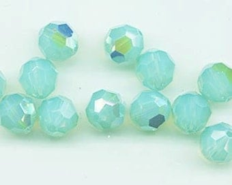 Twelve Swarovski crystals: art 5000 - 8 mm - pacific opal AB