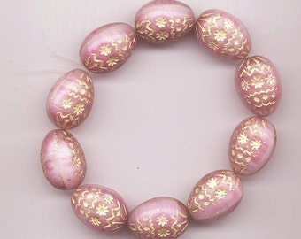 Four Czech glass beads - muted swirled pink with embossed gold design - 19 x 14 mm