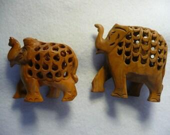 Hand Carved Wooden Elephants with Elephants Inside  2 Pcs.