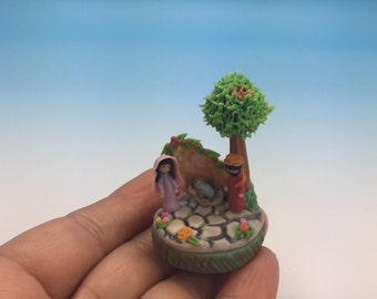Miniature nativity on pistachio shell.
