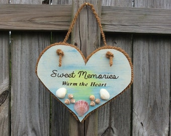 "Sweet Memories Warm the Heart. Heart shaped sign with shells from Navarre Beach, FL . 11"" by 9"""