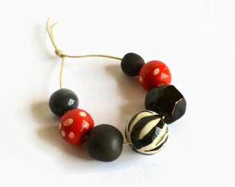 Black, white, red handmade ceramic beads, African beads, handmade African beads, ceramic beads, zebra print bead, pottery beads from Africa