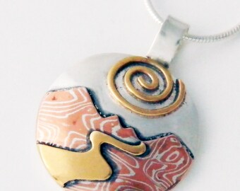 Mixed metal jewelry- mountain river landscape jewelry mokume gane mountain and spiral sun pendant