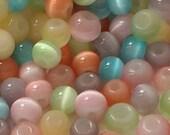petite eco friendly pastel glass moon glow beads//pink green orange blue yellow--lot of 100+