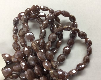 Coated Brown Moonstone Ovals Faceted