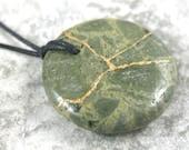Kintsugi (kintsukuroi) green brecciated jasper round pendant with gold repair on black cotton cord - OOAK