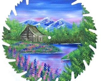 Hand Painted Saw Blade Mountain Spring Log Cabin