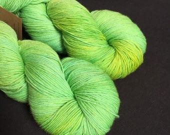 Grass hand dyed merino sock yarn