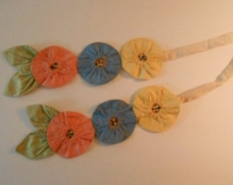 vintage curtain tie backs, yoyo flowers