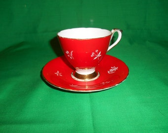 One (1), Bone China, Footed Tea Cup and Saucer, from Sutherland China, in the 314 Pattern.