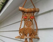 midcentury macrame owl with driftwood and orange wooden beads