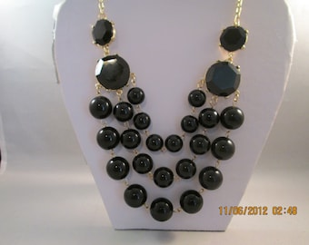 3 Strand Bib Necklace with Black Beads on a Gold Tone Chain