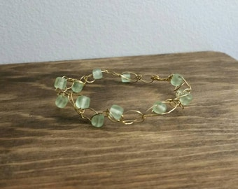 Gold wire crochet bracelet with green beads
