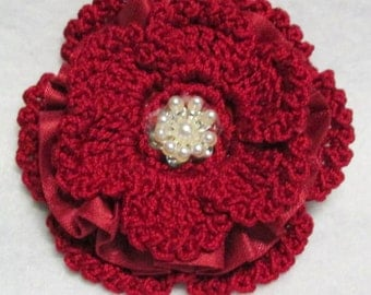 Handmade red crochet flower on alligator clip with teeth