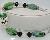 GREEN EYED SKULL :  Artist Lampwork Glass Sugar Skull Bracelet