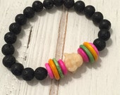 Lava stone beaded bracelet with cream buddha and beon accent beads