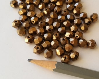 48 Faceted bronze color glass beads 7mm