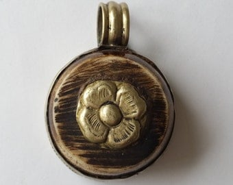 Nepal pendant with flower and animal