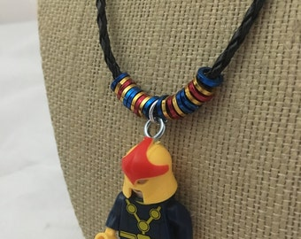 Nova Mini Figure Character Necklace. Small figure on embellished leather cord necklace.