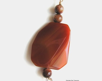 Carnelian agate pendant with goldstone beads, brown, rust, wire wrapped, gift under 20