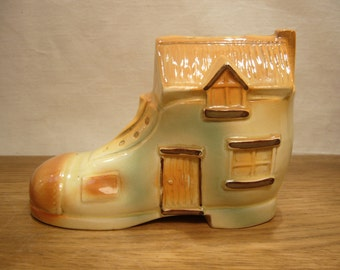 Vintage 1950s pottery money box in the shape of a shoe house