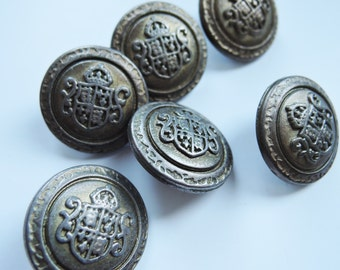 Lovely metal coat of arms buttons