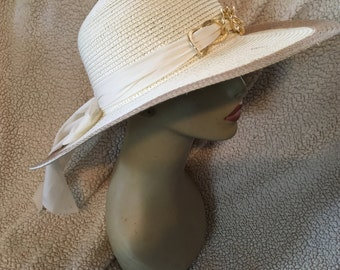 "Ladies vintage straw wide brim sun hat n great condition 21 1/2"" nice bow in back"