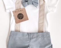 Beige suspenders and blue pinstripe bowtie and shorts/pants set sizes 0000-1