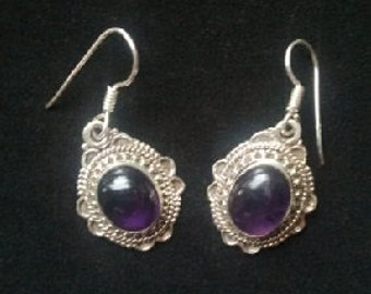 Amethyst cabachon style sterling silver earrings