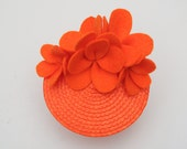 1940s-1950s inspired pin up aloha style round fascinator hat with Hawaiian bright orange felt flowers