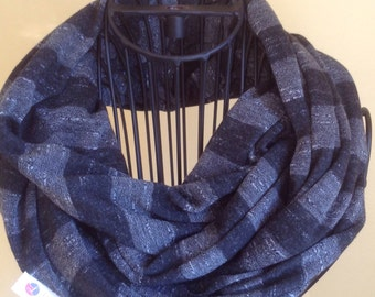 Black and gray striped infinity scarf.