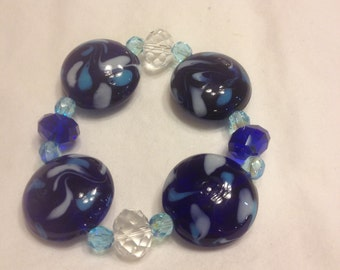 blue, teal and white blown glass beads