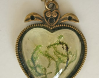 moss in heart shaped resin pendant