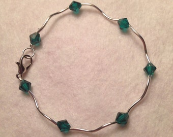 Green crystal and silver beaded bracelet