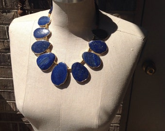 Blue Lapis Necklace,18 to 20inchs long, gold lobster clasp with chain. 2inch center stone.