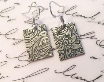Pewter filigree earrings on sterling silver ear wires.