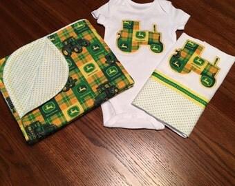 John Deere baby onesie, burp cloth, and blanket