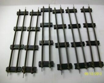 Lionel 2 rail train tracks black ties. 0 gauge 8 straight 5 telephone poles