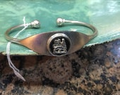 Silver bracelet with onyx and lion of judah made in Ethiopia