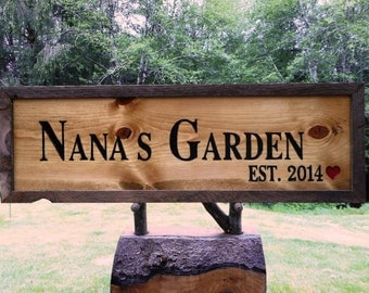 Barn beam framed garden sign with established date, NANA'S GARDEN carved on golden knotty Pine wood with an old Douglas fir barn beam frame