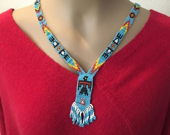 Vintage seed bead necklace with Thunderbird detail and fringe