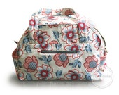 Weekender duffel bag style diaper bag with easy access wipes pocket